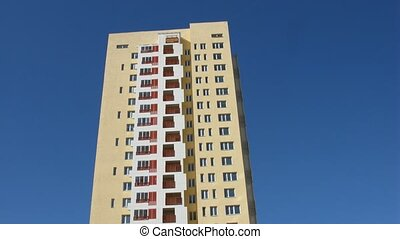 High-rise building covers with shadow as sun path by, time...