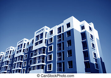 high-rise building in the blue sky, colorful, very tall and ...