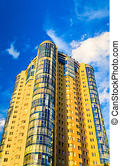 High-rise building on a background of blue sky
