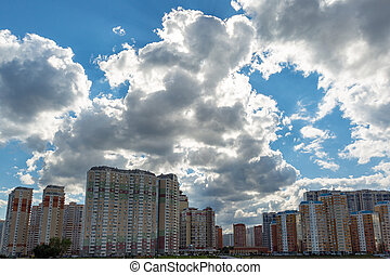 High-rise buildings against the sky on a background of a cloudy sky