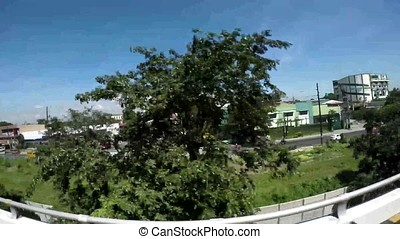 High rise buildings and overpass roads filmed from a moving...
