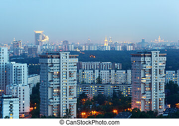 High-rise buildings at evening in Moscow, Russia; panorama of city