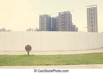 High Rise Buildings Behind Construction Fence