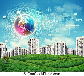 High-rise buildings over green hills. Brightly coloured Earth, charts and other virtual items in sky
