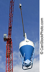 High rise Crane and Concrete mixer - The red construction...