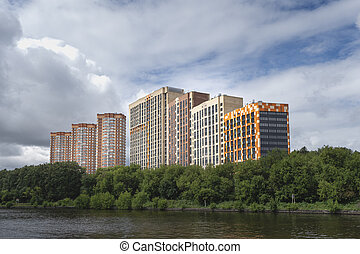 High-rise new buildings on a green hill. Khimki District, ...