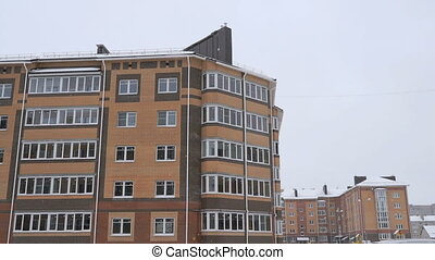 The high-rise residential buildings in snowy weather