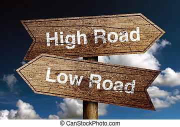 High Road And Low Road concept road sign with blue sky ...