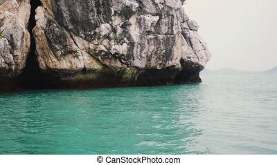 High rocks in the sea. slow motion. Thailand.