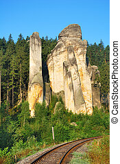 High sandstone tower with single track railroad