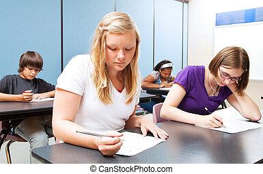 High School Class Test - Pretty blond girl taking a test ...
