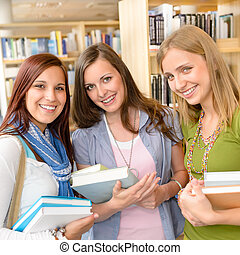 High school classmates with library books