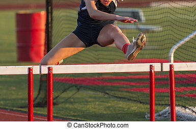 High school female racing in the hurdles