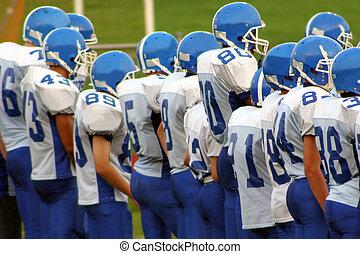 High School Football - High school football team on field.