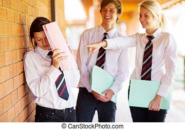 high school girl being bullied by classmates