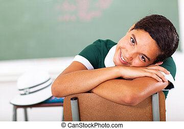 high school girl resting her head on the chair - cute high...