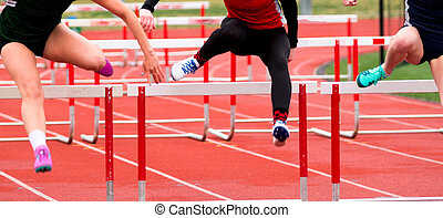 High School girls racing in the hurdles