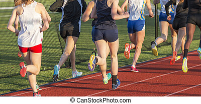 High school girls racing the mile