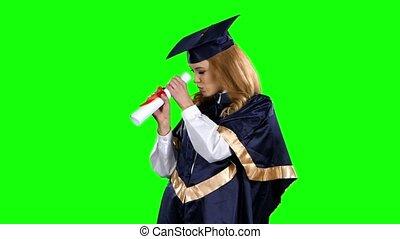 High school graduation. Obtaining a diploma. Graduate. Green...