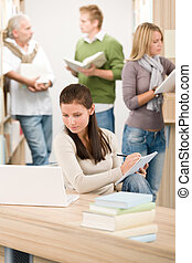 High school library - Student with note pad - High school...