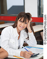 High School Student Leaning At Desk