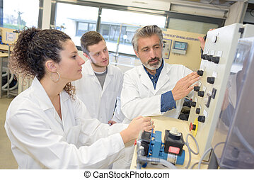 high school students and teacher in the laboratory
