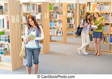 High school students at library read books