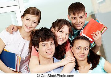 High school students - Portrait of five students embracing...