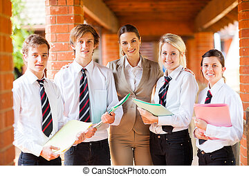 high school teacher and students