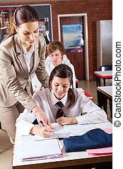 high school teacher helping student
