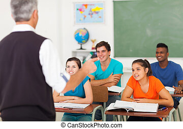 high school teacher teaching students