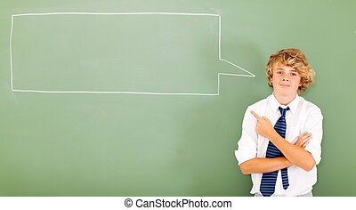 high school teen student pointing at chat box drawn on chalkboard
