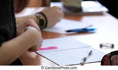 High school teenage students at the desk during classwork