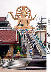 High seated golden Buddha statue