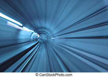 High speed - Abstract blue tunnel with motion blur at high ...