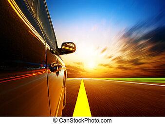 high-speed car - A car driving on a motorway at high speeds...