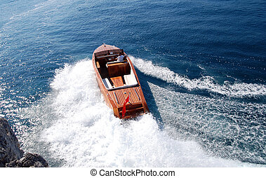 High Speed Classical Motorboat on action on sea