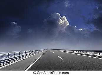 High-speed highway against the backdrop of an overcast sky.