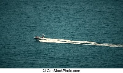 High-speed motorboat moving at sea - High speed motorboat...
