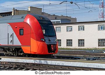 High-speed passenger electric train on the platform close-up.