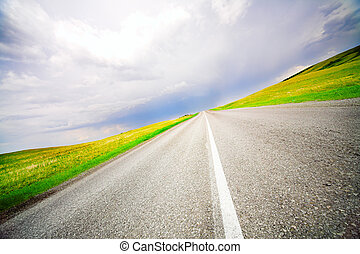 speed road  - High speed road with cloudy sky background