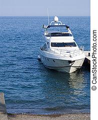 High-speed sea boat at a mooring