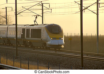 High speed sunset - High speed train TGV in France at sunset...
