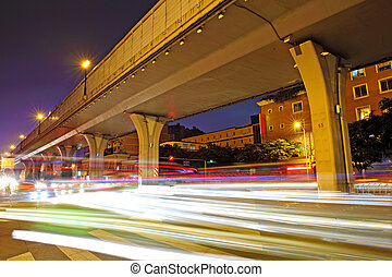 High speed traffic and blurred light trails under the overpass