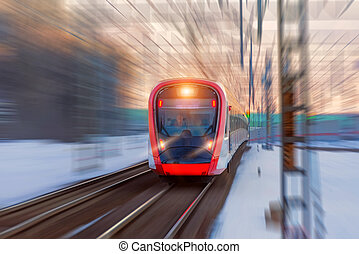 High-speed train departs from the passenger platform.