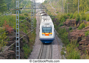 High Speed Train moving through the rocky place