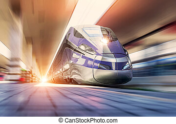 High speed train on a clear day with motion blur at the city station
