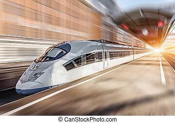 High speed train passing near the passenger station.