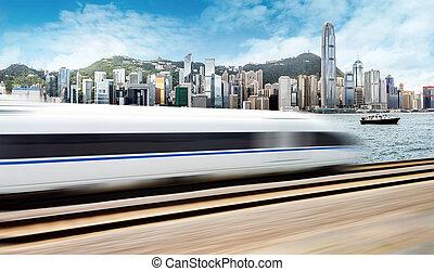 High-speed train through the modern city