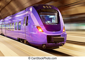 Modern high speed train with motion blur effect at the railway station